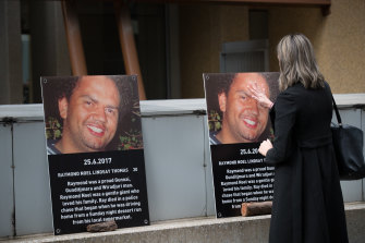 Posters of Raymond Noel posted to the outside walls of the coroners court during the inquest into his death.