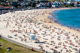 Bondi Beach was pumping with people on Sunday as Sydney's Eastern suburbs residents made the most of their 5km radius on the 30 degree day.