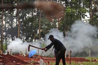 A gravedigger prepares a grave for a COVID-19 victim at Cipenjo cemetery in Bogor, West Java on Wednesday.