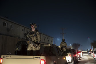 Soldiers stand guard in the motorcade for then president Donald Trump when he visited Afghanistan in 2019.
