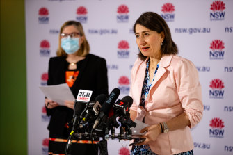 Chief Health Officer Kerry Chant and Premier Gladys Berejiklian at Sunday's COVID-19 press conference. From Monday, the briefing will not be held daily.