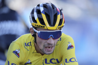 Primoz Roglic gasps at the final stage of Paris-Nice on Sunday.