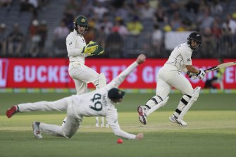 Steve Smith makes a diving attempt to catch Ross Taylor during the Perth test.