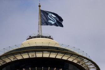 The Kraken logo flies above Seattle's famous Space Needle.