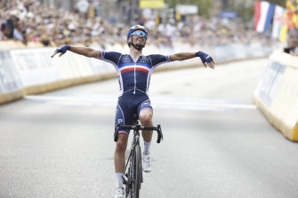 Frenchman Julian Alaphilippe crosses the line to win his second world road race title.