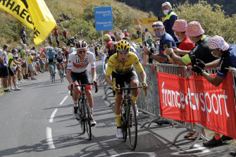 Slovenia's Primoz Roglic, in the leader's yellow jersey, with compatriot Tadej Pogacar on a tough day of climbing.
