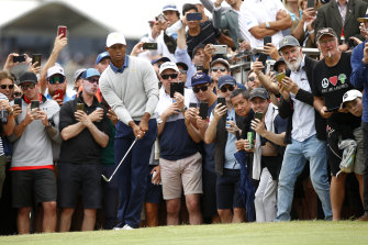 Tiger Woods is watched by a packed gallery at the Presidents Cup on Friday.