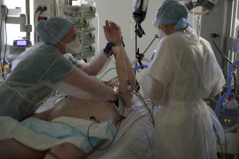 Medical workers tend to a COVID-19  patient at the Amiens Picardie hospital, in Amiens, France.