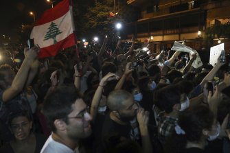 Anti government protesters chant slogans against the Lebanese political class, while French President Emmanuel Macron visits Lebanon's diva Fairouz in Beirut.
