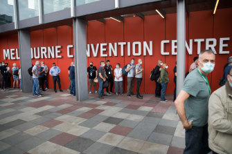People line up for hotel quarantine training at Melbourne Convention Centre on Saturday.