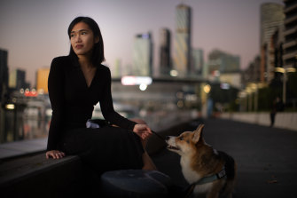 Lia Mills with her dog Butter on Wednesday. She doesn't know when she will see her mother, who is in Indonesia, again.