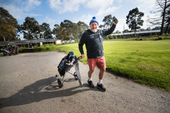 Marshal Toohey celebrates being able to chase a white ball around Yarra Bend Golf Course.
