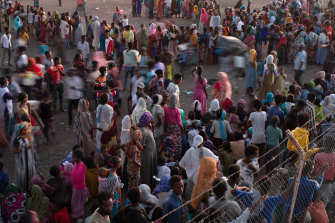 Ethiopian refugees wait in Hamdayet, Sudan for supplies from the UN Refugee Agency, in December.