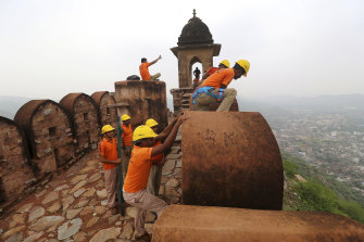 State Disaster Response personnel perform a search operation at a watchtower of the 12th century Amber Fort where 11 people were killed after being struck by lightning in Jaipur, Rajasthan state, India.