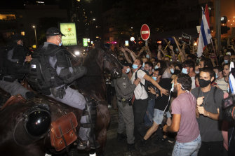 Israeli demonstrators scuffle with police officers during a protest in Tel Aviv on Saturday.