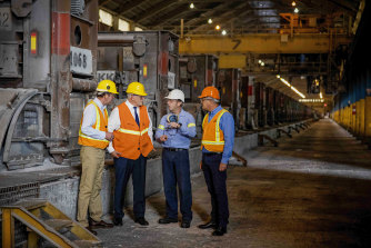 Prime Minister Scott Morrison and Trade Minister Dan Tehan at the Portland smelter with plant manager Ron Jorgensen and Alcoa Australia president Michael Gollschewski on Friday.