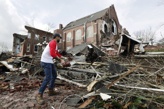 Sumant Joshi helps to clean up rubble at the East End United Methodist Church after a tornado struck.