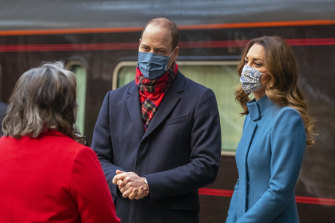 Prince William and Kate arrive by train at Edinburgh station on Monday.