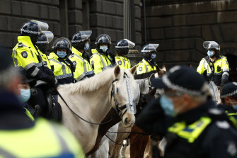 The mounted branch during a protest in  the Melbourne CBD in August.
