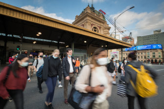 Workers returning to the Melbourne CBD at Flinders Street Station earlier this month.