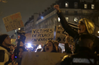 Women's rights activists protest near Friday's Cesar ceremony in Paris because Roman Polanski's latest film led the nominations.