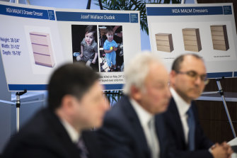 Placards showing images of two-year-old Jozef Dudek and IKEA's Malm dressers are displayed during a news conference in Philadelphia on Monday.