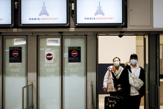 Travellers from Beijing arrive at Charles de Gaulle Airport in Paris prior to the suspension of flight from China in January.