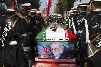 The Iranian Defence Ministry, military personnel stand near the flag-draped coffin of Mohsen Fakhrizadeh, a scientist who was killed on Friday, during a funeral ceremony in Tehran, Iran.