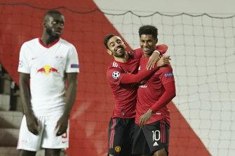 Bruno Fernandes and Marcus Rashford celebrate one of United's five goals against Leipzig.