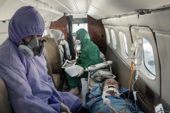 Felicindo Delgado, 68, who had severe coronavirus symptoms, is flown from the village of Coari to receive care in Manaus, days before he died.