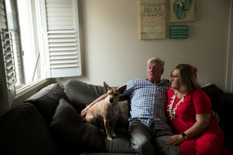 Former Roosters player John Higgins with his wife Simone and their dog Casper.