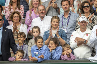 Federer's wife, Mirka (centre), with (at front) their twin girls, Charlene  and Myla, and twin boys, Lenny  and Leo.