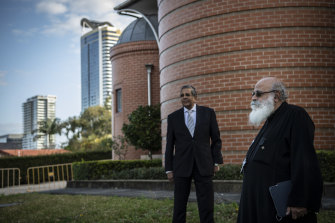 Senior parish priest Youhanna Bestawros, right, and church member Max Gergis outside the Coptic Church in Rhodes.