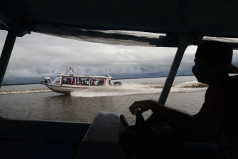 A medical team from Manacapuru travel the Amazon by boat to test residents for coronavirus in communities unreachable by road, in Ilha Marrecão, Brazil.