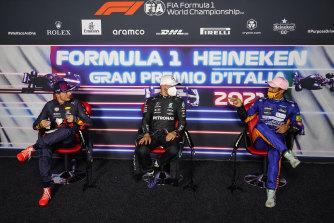 Max Verstappen, Valtteri Bottas and Daniel Ricciardo talk during a press conference.