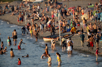 Beachgoers on Kitsilano Beach during a heatwave in Vancouver, British Columbia, Canada, on Monday, June 28, 2021.