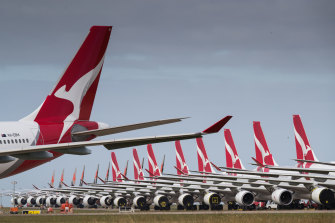 Qantas planes lined up for storage at Avalon Airport. Most of Qantas' and Virgin's jets are grounded, but business could pick up as travel bans lift.