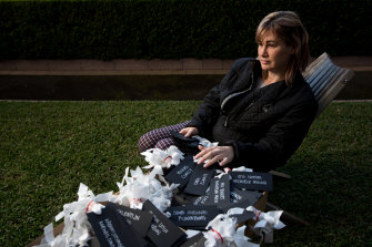 Jane Malcolm with the names of all the MH17 victims, including her mum and step-dad, Carol and Michael Clancy, which will be hung outside the Russian Consulate in Sydney.