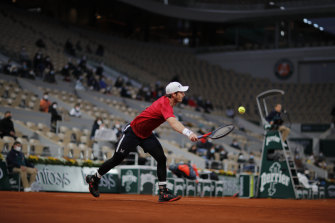 Winter tights, but few spectators: Andy Murray loses to Stan Wawrinka in the opening round.