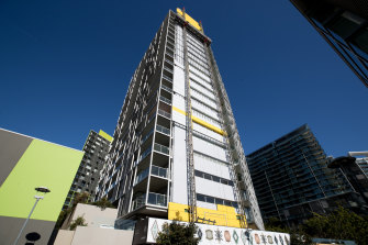 Cladding was removed last year from the Distillery apartment tower at Pyrmont in inner Sydney.