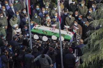 Military personnel carry the flag-draped coffin of Mohsen Fakhrizadeh at his funeral on Monday.