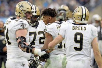 Michael Thomas, centre, celebrates with teammates after scoring a touchdown against the Titans.