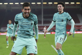 Roberto Firmino, whose goal was subsequently ruled a Sheffield United own goal, and Curtis Jones celebrate during Liverpool's 2-0 Premier League win.