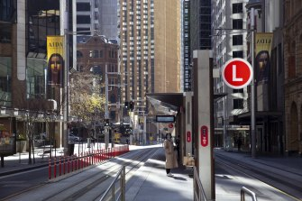 Commuters in the nearly empty Sydney CBD during a Covid-19 lockdown.