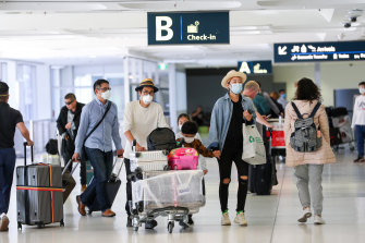New rules: Arriving travellers at Sydney International Airport on Sunday.