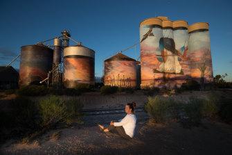 Julie Pringle near painted silos.