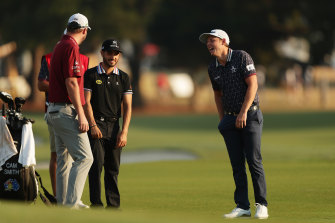 Smith shares a laugh with friend Marc Leishman and Mexico's Abraham Ancer at the Australian Open in Sydney.
