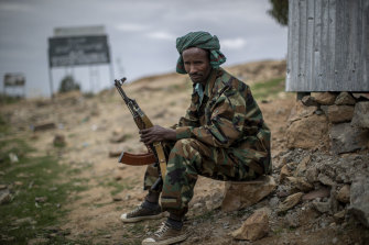 A fighter loyal to the Tigray People's Liberation Front mans a guard post on the outskirts of the town of Hawzen, then-controlled by the group, in the Tigray region of northern Ethiopia in May.