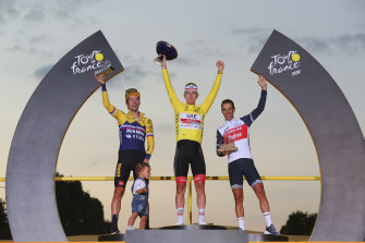 Richie Porte, right, on the Tour de France podium next to winner Tadej Pogacar, centre, and runner-up Primoz Roglic.
