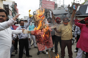 Indians in Lucknow burn an effigy of Chinese President Xi Jinping during a protest against the Chinese government on June 17 following clashes on the Himalayan border.
